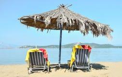 Parasol on the beach. Palm beach umbrellas at the beach Royalty Free Stock Photos
