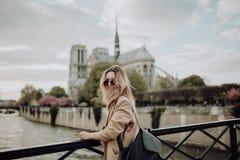 Vacation in Paris. Lucky girl on bridge stock photo