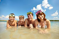 On vacation. Photo of happy family looking at camera during summer vacation Stock Photography