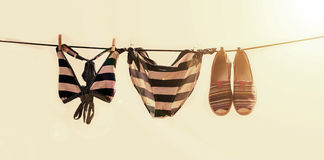Vacation photo of swimsuit drying on the clothesline Royalty Free Stock Image