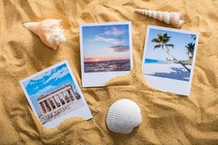 Vacation Photos On Beach. High Angle View Of A Vacation Photos On Sandy Beach Stock Photography
