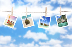 Vacation photos hanging on a rope. Thailand Royalty Free Stock Images