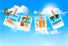 Vacation photos hanging on a rope. Royalty Free Stock Image