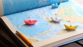 Vacation planner idea. Vacation planner concept , paper boats on the map stock video