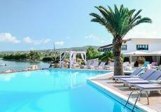 Summer dreams. Pool overlooking the blue sea Stock Photos