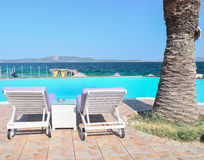 Deck chair. Pool overlooking the blue sea Stock Image