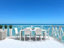 Vacation por el mar en una terraza hermosa Imágenes de archivo libres de regalías