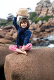 Vacation postcard concept with smiling child raising hat for hello Stock Photography