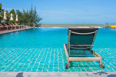 Vacation and Relaxation Concept : Daybed beside swimming pool in the resort. Royalty Free Stock Photo