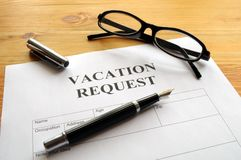 Vacation request. Form in business office showing holiday concept Stock Images