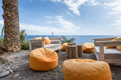 Vacation resort with comfortable seats near the sea at Madeira Island Royalty Free Stock Images