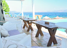 Restaurant on the Greek island. Restaurant overlooking the pool and the blue sea Stock Images