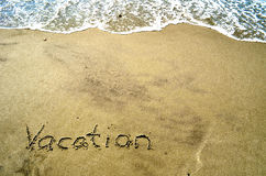 Vacation In the Sand. Vacation Written In the Sand Stock Photos