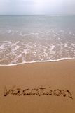 Vacation in sand vertical. Royalty Free Stock Images