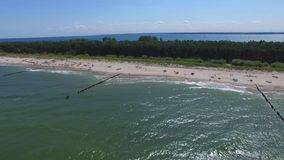 Vacation by the sea, aerial view. Baltic Sea -Hel Peninsula, dji inspire, Poland, blue sky, holidays, tourists on the beach, aerial view, waves at sea, lagoon stock video footage
