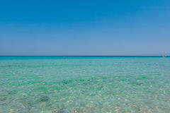 Vacation on the sea, Crystal clear sea water texture with glare Stock Image