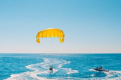 Vacation on sea resort - fun on parasailing. Positive human emotions, feelings, family travel, vacation on sea resort - fun on parasailing stock image