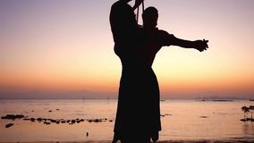 Vacation at the sea, the sunset and couple in love on a swing. slow motion. 1920x1080. Vacation at the sea, the sunset and love on a swing. slow motion stock video footage