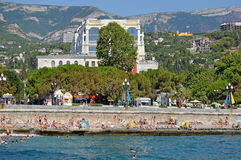 Vacation by the sea on the waterfront in the city of Yalta. Crimea, Ukraine. Summer 2012 Royalty Free Stock Photos