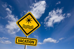 Vacation sign. Over blue sky Royalty Free Stock Photo