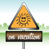On vacation sign. Yellow sign with smiling sun symbol and the text on vacation written below the sign Royalty Free Stock Photos