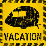 Vacation sign with nostalgic trailer Stock Photo