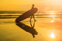 Vacation Silhouette Of A Surfer Carrying His Surf Board Home At Sunset With Copy Space.  Stock Images
