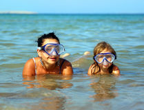 Vacation - snorkeling daughter with mother Stock Photography