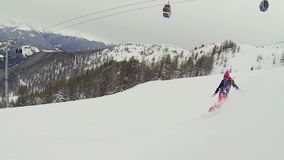 Vacation snowboarding. Beautiful full HD action video footage of a young girl snowboarding stock footage