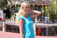 Vacation in Spain. Smiling girl over amusement park background Stock Image