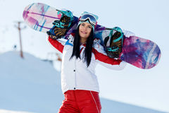 Vacation of sportswoman with snowboard Royalty Free Stock Image