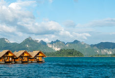 Vacation Start Here Concept, Beautiful Wooden Floating House in Peaceful View of Ratchaprapa dam , Khao sok national park Stock Image