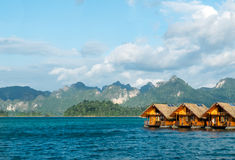 Vacation Start Here Concept, Beautiful Wooden Floating House in Peaceful View of Ratchaprapa dam , Khao sok national park Royalty Free Stock Photography