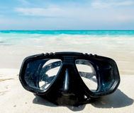 Vacation Start Here Concept, Scuba Diving Equipment On The White Sea Sand Beach with Crystal Clear Sea and Sky in Background used Stock Image