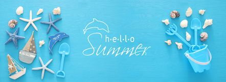 Vacation and summer banner with sea life style objects and beach toys for kid. Vacation and summer banner with sea life style objects and beach toys for kid Royalty Free Stock Photo