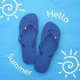 Vacation and summer image with flipflops over blue wooden background. Vacation and summer image with flipflops over blue wooden background stock photos