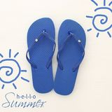 Vacation and summer image with flipflops over white wooden background. Vacation and summer image with flipflops over white wooden background royalty free stock photography