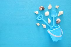 Vacation and summer image with sea life style objects and beach toys for kid. Vacation and summer image with sea life style objects and beach toys for kid Stock Photos