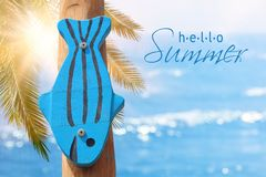 Vacation and summer image with wooden decorative fish in front of the sea landscape. Vacation and summer image with wooden decorative fish in front of the sea Royalty Free Stock Photos