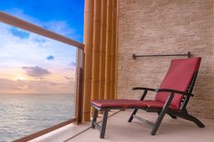 Free Vacation Sunset Concept With Beach Chair At Balcony For Relax Near Beach, Sea Scape Royalty Free Stock Image - 130992506