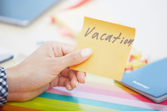 Vacation text on adhesive note Stock Photos
