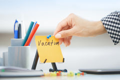 Vacation text on adhesive note Stock Images