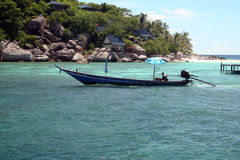 Vacation Thailand. The beautiful island of Koh To near Koh Samui. This boat is used to ferry small group of tourist Stock Image