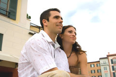 Vacation time. A man and a woman sitting in a town, looking ahead royalty free stock photos