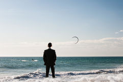 Vacation time finally. Mixed media. Businessman standing on ocean coast and enjoying the view. Mixed media Stock Photo
