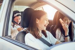 Vacation time and travel, three beautiful young women cheerful travels together for a relaxing holiday. royalty free stock images