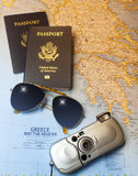 Vacation to Greece. Map of Greece with Two American passports, sun glasses and camera Stock Image