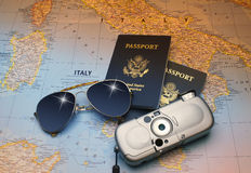 Vacation to Italy. Map of sunny Italy with Two American passports, sun glasses and camera Royalty Free Stock Images