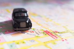 Vacation tour concept. Toy car on a map. royalty free stock image