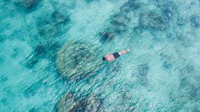 Vacation tourist snorkel man swimming snorkeling in paradise clear water. Swim boy snorkeler in crystalline waters and coral reefs stock photography